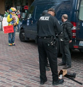 Police arrest a photographer during a May Day protest in Seattle. (Michael Holden / Flickr)