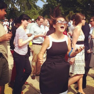 The author celebrates the Affordable Care Act ruling outside the Supreme Court. Photo courtesy of Slate's Dave Weigel.