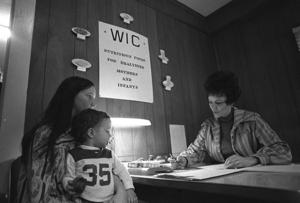 Mother and child applying for WIC food stamps