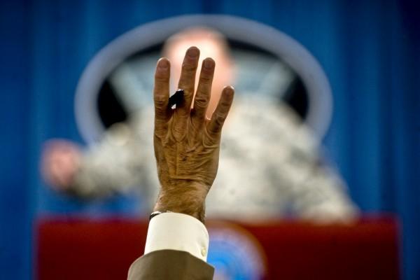 He Raises His Hand